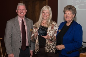 County commissioners Casey Tighe (left) and Faye Griffin (right) receive 2013 Meyer Award from JCHC chair Rose Lewis on behalf of Jefferson Co. Open Space at October Hall of Fame event. Photo by Matthew Lewis.