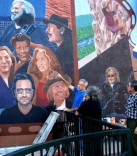 During his work on the Morrison mural in September 2007, Emanuel pauses to discuss his project with admirers who stop by.
