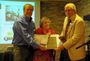 Nominators Beth Simmons (center) and John Ghist (right) present landmark plaque to Tim Sandsmark.