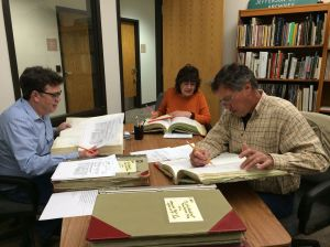 Researchers Bob and Kris Autobee and Lyle Miller take advantage of available records in the Archives Reading Room.