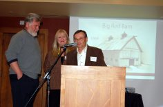 Dr. Burdette Weare presented the landmark plaque for the Big Red Barn in Conifer to Debra and Gary Wysocki.